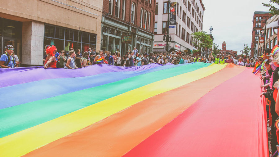 Adult Architecture Building Exterior Built Structure Celebration City Crowd Day Festival Flag Group Of People Large Group Of People Lgbt Lifestyles Men Multi Colored Outdoors Pride Pride Parade Rainbow Real People Street Women Love Is Love