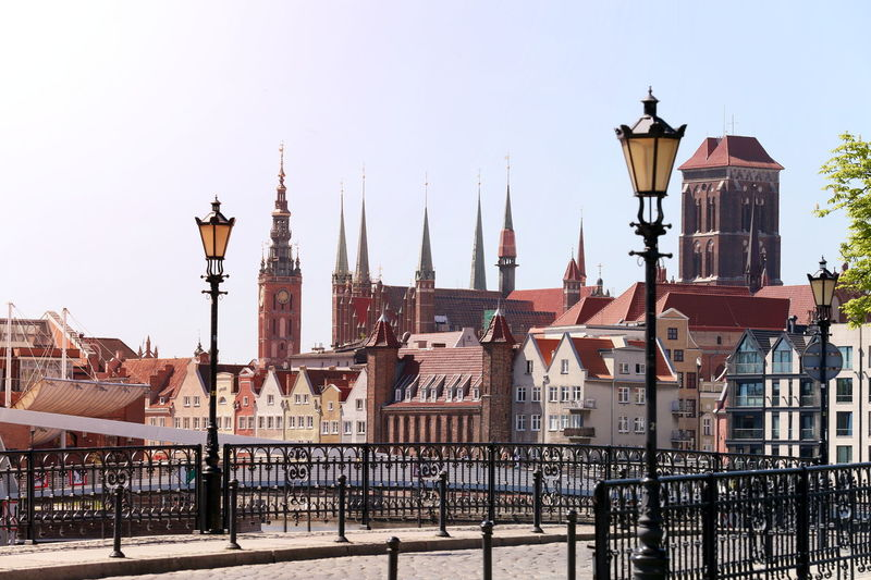 Old Town Architecture Building Building Exterior Built Structure City Clear Sky Day Gdansk Lamps No People Outdoors Place Of Worship Railing Religion Residential District Row House Sky Spire  Street Street Light Tower Travel Travel Destinations My Best Travel Photo