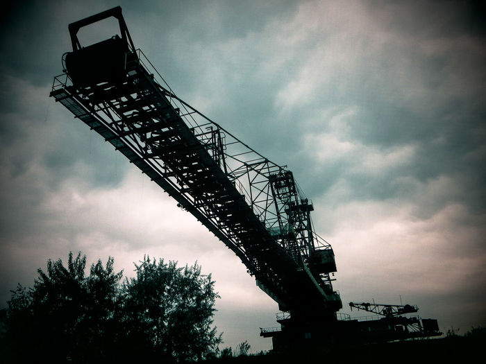 Brown Coal Mine Architecture Brown Coal Surface Mining Area Built Structure Cloud - Sky Construction Site Day Development Ferropolis Industry Low Angle View Mining No People Open-cast Mining Outdoors Silhouette Sky Tree