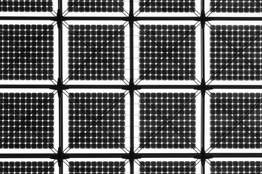 Directly below shot of solar cells on glass roof against sky Modern Roof Solar Panel Abstract Abundance Architectural Feature Architecture Backgrounds Black And White Built Structure Ceiling Checked Pattern Close-up Design Directly Below Full Frame Geometric Shape Glass - Material Indoors  Metal Pattern Repetition Square Shape Stability Symmetry
