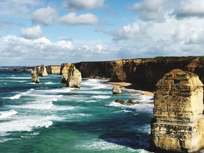 Scenic view of twelve apostles against cloudy sky