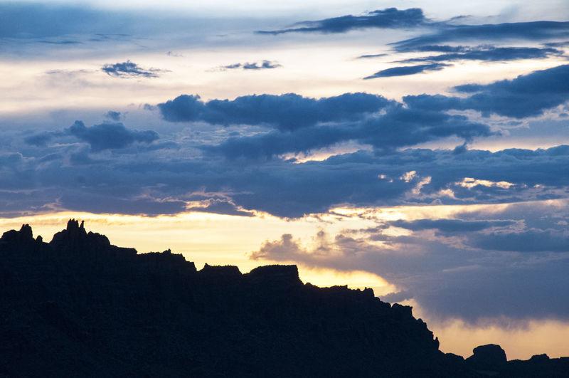 Desert Desert Tower Moab  Utah Beauty In Nature Cloud - Sky Dramatic Sky Dusk Environment Landscape Mountain Mountain Range Nature No People Outdoors Rock Scenics - Nature Silhouette Sky Southwest  Sunset Tranquil Scene Tranquility
