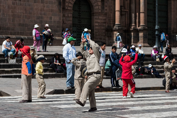 Boy scout doing a performance Boy City Day Full Length Motion Outdoors People And Places Performance Performer  Scout Street Street Photography Togetherness Uniform People EyeEm Diversity