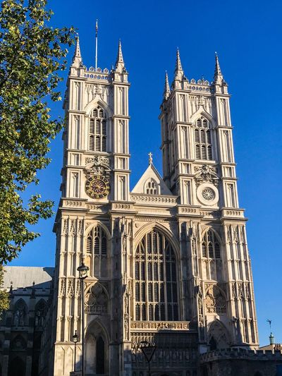 Religion Architecture Place Of Worship Spirituality Built Structure Building Exterior Low Angle View Day Outdoors History Sunlight No People Blue Travel Destinations Clear Sky Sky Westminster Abbey Postcode Postcards