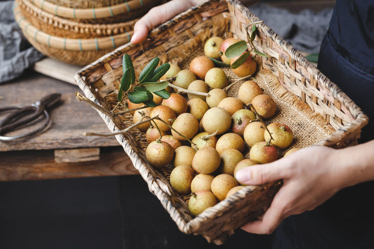 Fresh longan fruits from Vietnam ASIA Eating Isolated Rain Vietnam Bamboo Basket Delicious Food Food And Drink Freshness Fruit Healthy Eating Healthy Food Leaf Longan Longan Fruit Nutrition Old Wood Organic Still Life Sweet Tasty Tropical