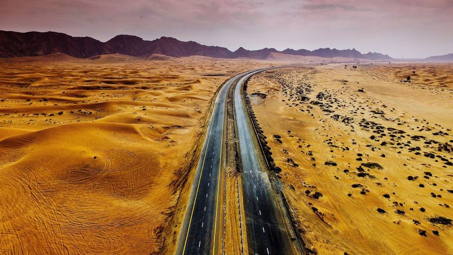 Desert road Landscape Desert Nature Scenics Sky Arid Climate Transportation Outdoors Beauty In Nature Non-urban Scene Tranquility The Way Forward Sand Day Road No People Sand Dune Mountain Adapted To The City Lieblingsteil