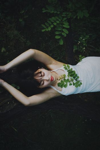 One Person Lying Down Plant Young Adult Leisure Activity Portrait Real People Nature Relaxation Beauty High Angle View Women Young Women Lying On Back Grass Lifestyles Day Looking At Camera Beautiful Woman Outdoors Girly Pretty♡ Beauty In Nature Pretty Girl People Photography