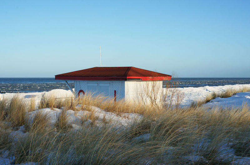 House By Baltic Sea Against Clear Sky During Winter