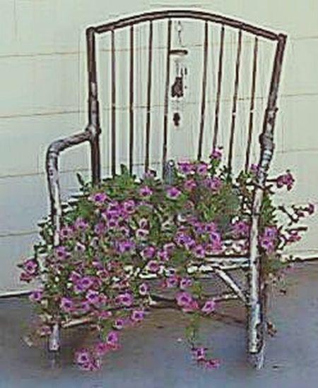 Flowers In Chair Repurposed Furniture