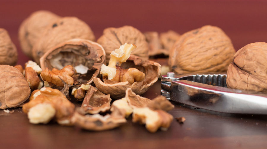 Close-up of cracked walnuts on table