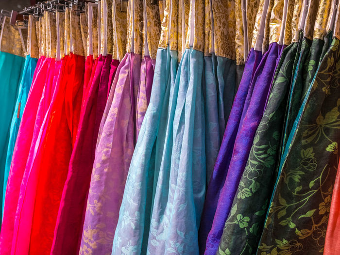 The colorful Hanbok, Korean traditional silk dress & ornaments for women.Rent for tourist. Arrangement Backgrounds Choice Clothing For Sale Full Frame Hanging In A Row Indoors  Large Group Of Objects Market Multi Colored No People Order Retail  Retail Display Sale Scarf Shopping Side By Side Still Life Store Textile Variation