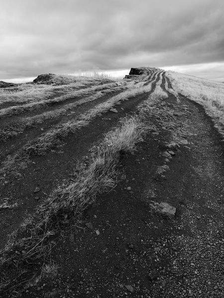 Wheel tracks towards clouds. Shot at Salisbury Crags cliffs, Holyrood Park, Edinburgh, UK. Artist Attractions Black And White Cliff Clouds Destination Edge Edinburgh Grass Holyrood Park Landscape Mountain Nature Path Road Ruts Salisbury Crags Sky Top Track Travel