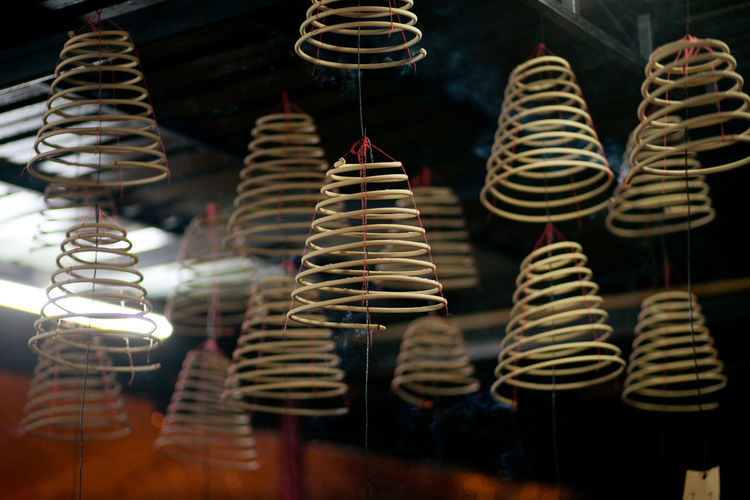 Spiral Incenses Hanging In Temple