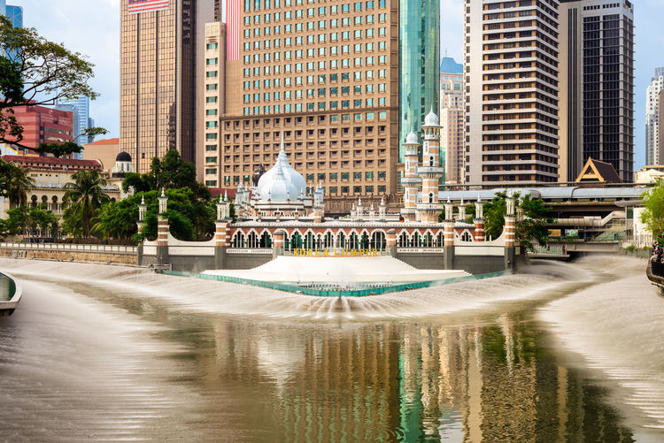 View of fountain in city buildings
