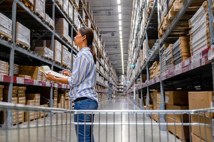 Entrepreneur checking list in warehouse