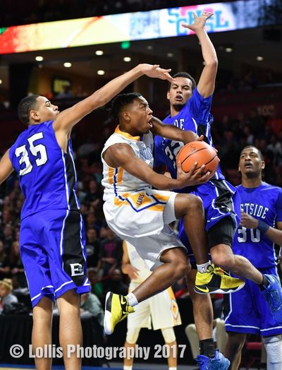 A Wren Hurricanes player goes up for a layup in heavy traffic in the Upper State Championship game in South Carolina. Basketball Playoffs Wren Hurricanes