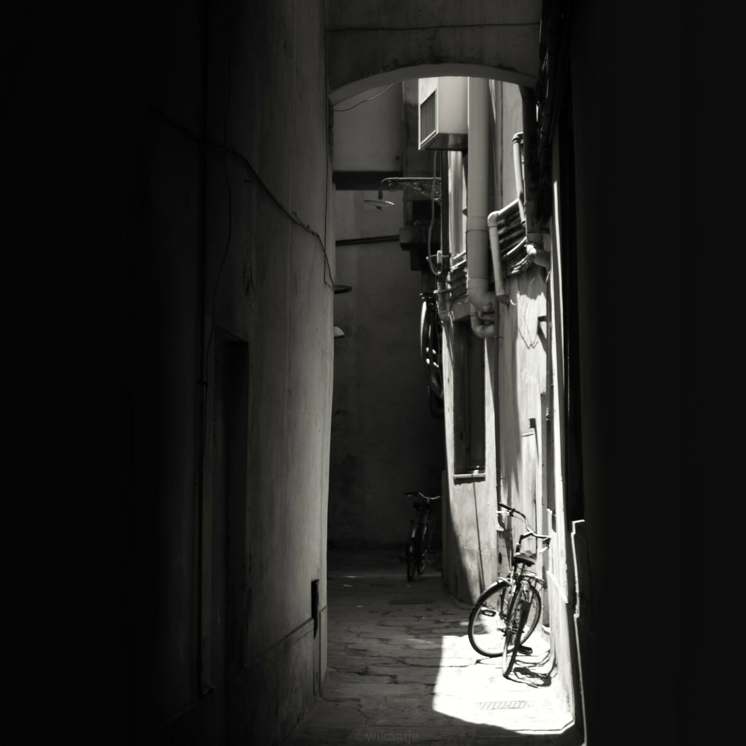 indoors, architecture, built structure, men, bicycle, window, door, sunlight, transportation, house, full length, day, building exterior, narrow, shadow, chair, absence, lifestyles