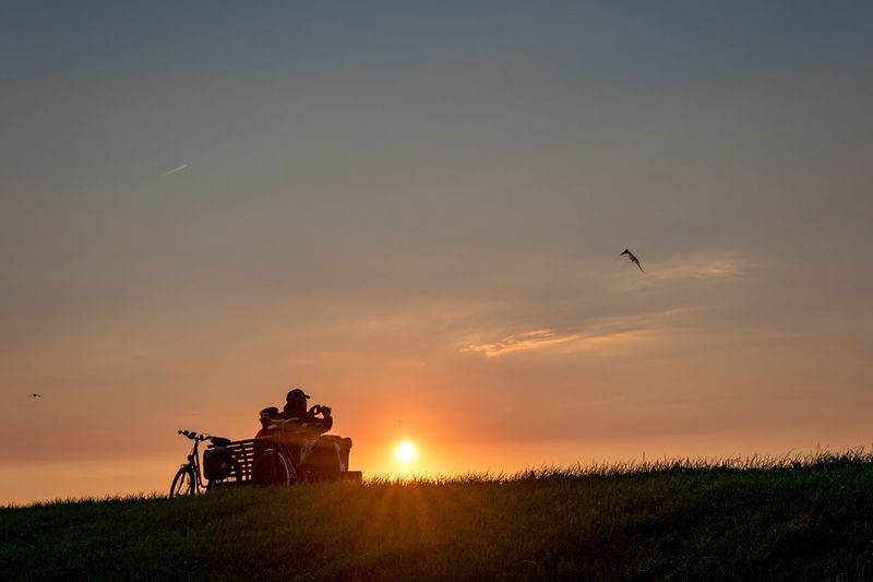 Neuharlingersiel, North Germany Sunset Field Beauty In Nature Nature Real People Sky Silhouette Scenics Tranquil Scene Grass Outdoors Men Tranquility Landscape Leisure Activity Growth Agriculture Two People Rural Scene Bench Kite Bike