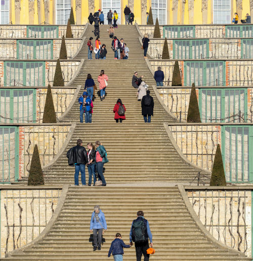 High angle view of people walking on staircase