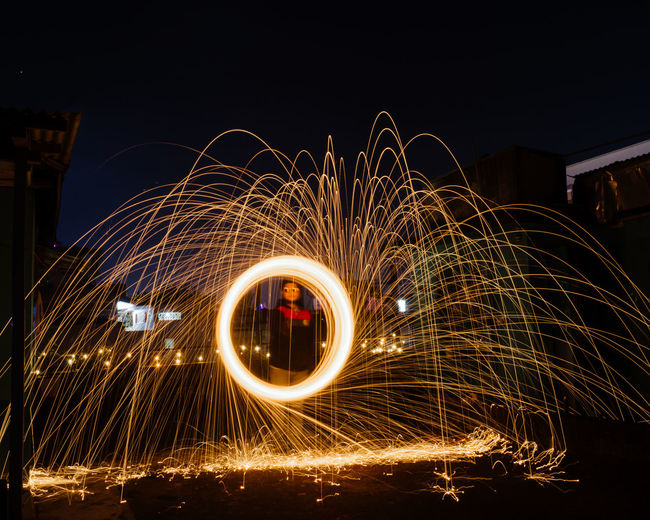 Light painting of firework display at night