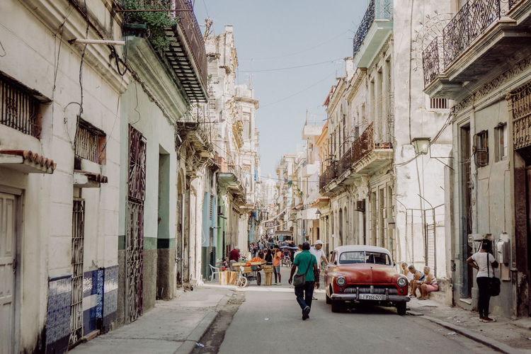 The Traveler - 2018 EyeEm Awards Been There. Cars City Life Cuba Havana Walking Around Architecture Building Exterior Built Structure Car City Day Full Length Land Vehicle Men Outdoors People Real People Sky Street Streetphotography Transportation Travel Destinations Vintage Cars