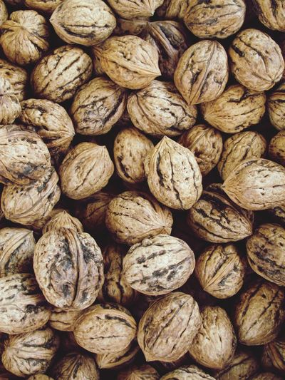 Nuts Full Frame Backgrounds Large Group Of Objects Abundance Food Food And Drink Nut Wellbeing No People Nut - Food Freshness Close-up Detail Brown Textured  Walnut Day Healthy Eating Still Life For Sale