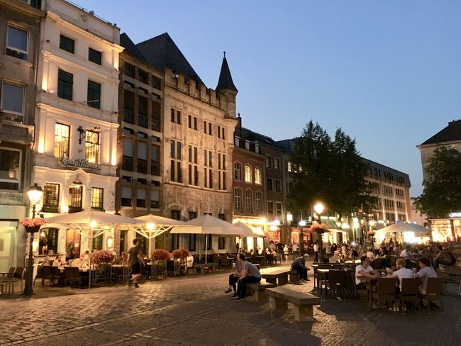 The warm atmosphere of downtown Aachen (Germany). City Life Architecture Built Structure Group Of People Dusk Street