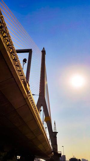 Architecture Bridge Built Structure Cable Car Capital Cities  City City Life Engineering Lens Flare Low Angle View Outdoors Pole Rama8 Sky Sun Sunbeam Sunlight Sunset Tall - High Travel Destinations