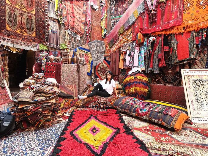 Colorful carpet Adult Architecture Art And Craft Carpet - Decor Clothing Creativity Day Indoors  Lifestyles Market Multi Colored Real People Textile Women