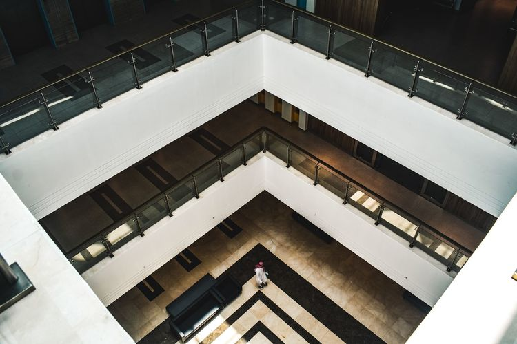 Low angle view of woman walking on building