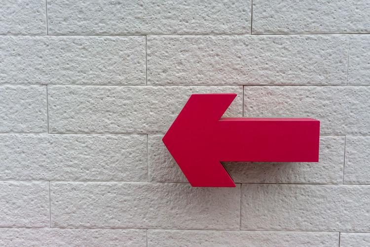 Pink arrow sign