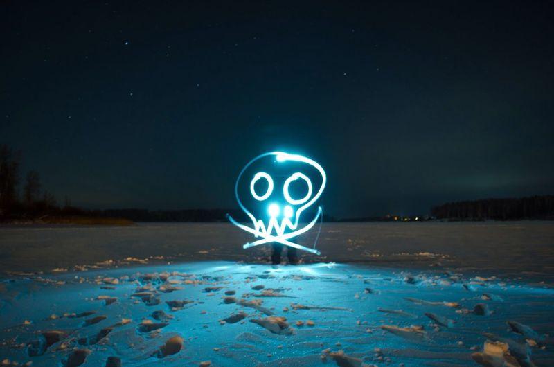 Skull and crossbones sign illuminated