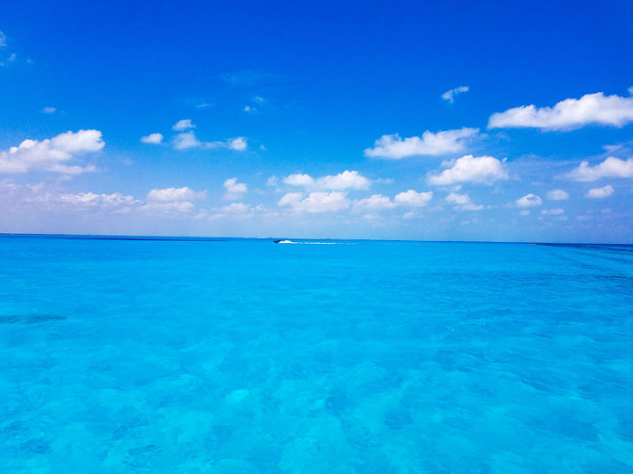 Blue Scenics Horizon Over Water Tropical Climate Sky Island Cloud - Sky Idyllic VacationsBeauty In Nature Tranquility Nature Travel Destinations Outdoors Water Travel Boat Clouds Vacation May 2017 Spring Springtime Cancun Mexico Isla Mujeres Mexico The Week On EyeEm