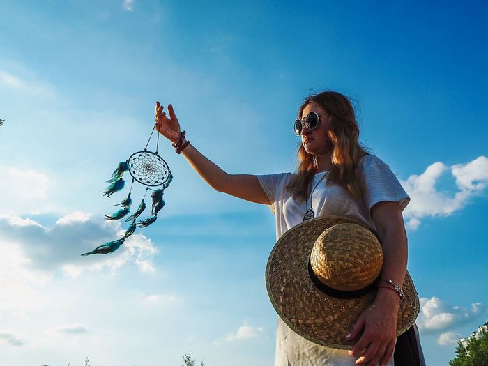 Woman holding Dreamcatcher and straw hat Sun Glasses Straw Hat Straw Hat Dreamcatcher Sky Women Nature Cloud - Sky Vertebrate One Person Flying Outdoors Females Arts Culture And Entertainment Fashion My Best Photo My Best Photo