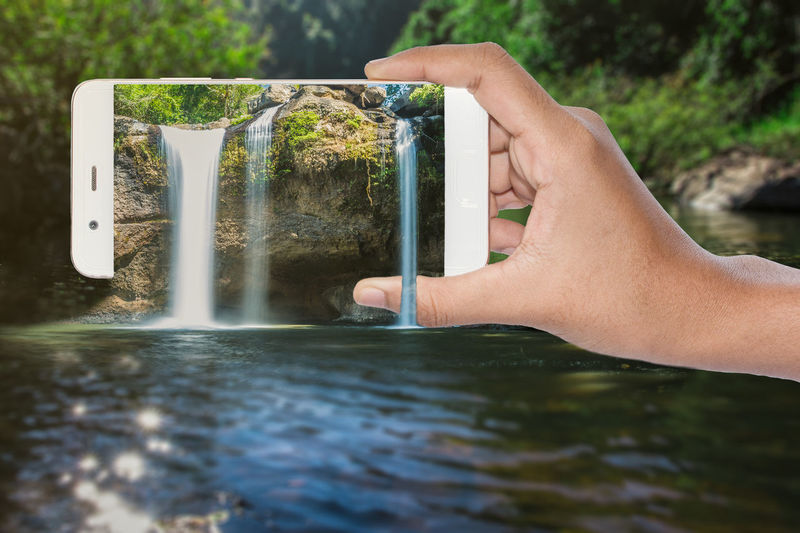 3D Pop Up Waterfall hand holding mobile phone (Haew Suwat Waterfall) 3D Popup Mobile Phone Close-up Day Grass Holding Human Body Part Human Hand Mobile Nature One Person Outdoors People Real People Reflection Water Waterfall EyeEmNewHere