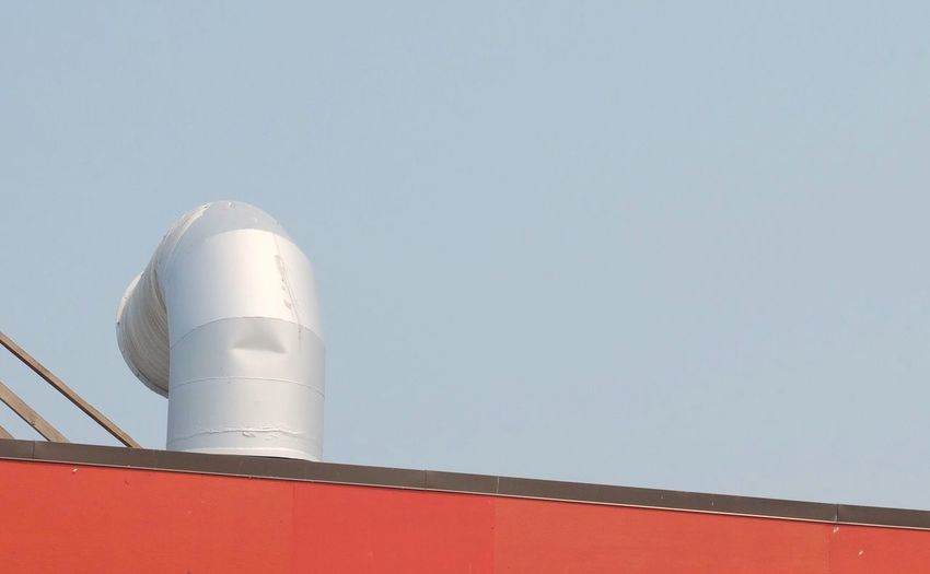 Low angle view of factory against clear sky