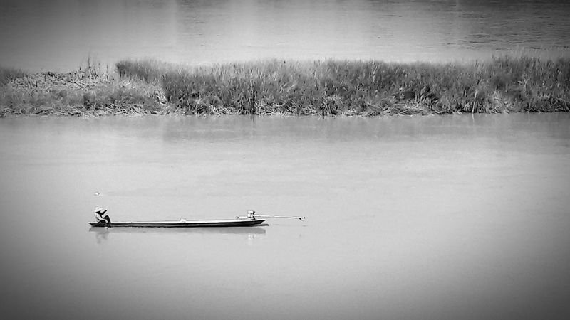 Bnw_friday_eyeemchallenge Bnw_dramatic_landscapes Boat River View Fishing Fisherman Fishing Boat Landscape Outdoors Nature Long Tail Boat Downstream
