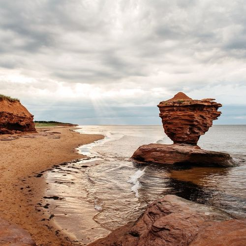 Beach Cliff Clouds And Sky Coastline Explore Geology Horizon Over Water Idyllic Landscape Nature Outdoors Physical Geography Remote Rock Rock - Object Rock Formation Sand Scenics Sea Shore Tranquil Scene Vacations