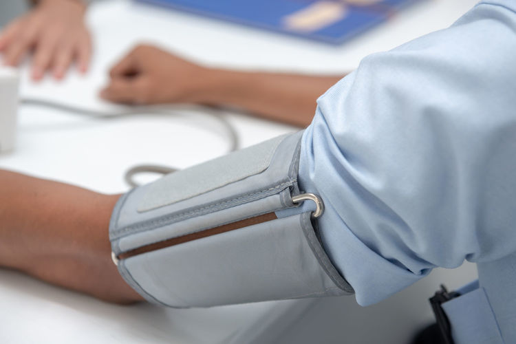 Close-up of blood pressure gauge on patient arm in hospital