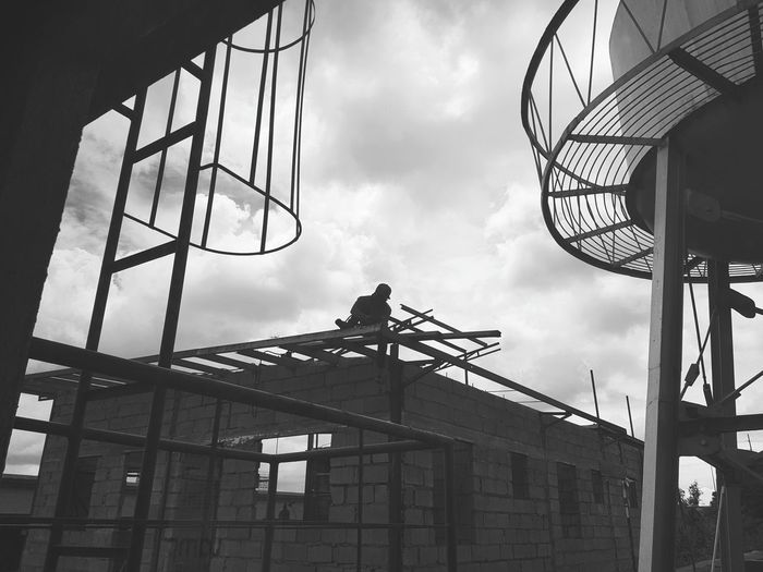 Life at Risk. Work for life. Workers At Work Hard Labor Safety First! Hard Workers The Street Photographer - 2018 EyeEm Awards City Construction Site Sky Architecture Building Exterior Built Structure Construction Building - Activity