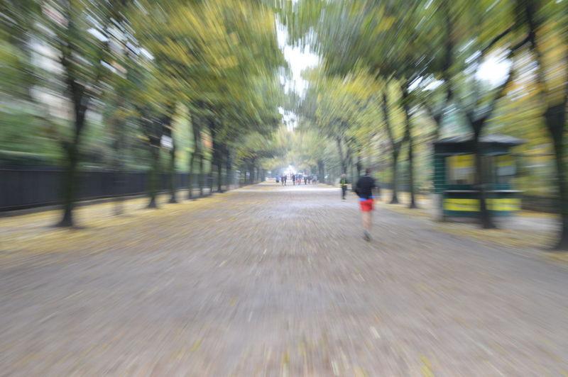 Defocused image of people walking on street in city