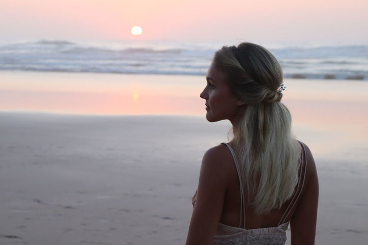 Woman at beach during sunset