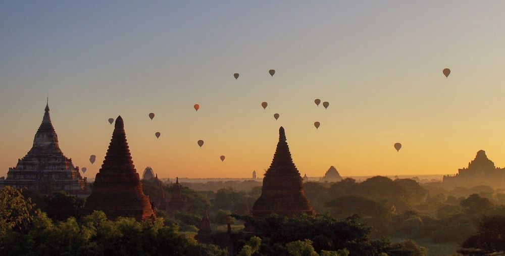 Hot air balloons over Bagan at sunrise. Myanmar Ancient Bagan Burma Cultures Hot Air Balloon Myanmar Pagoda Place Of Worship Religion Sunrise Temple EyeEmNewHere EyeEmNewHere