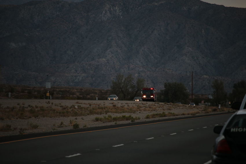 The fire department responding to a one car rollover accident on the 29 Palms Highway in Riverside County Car Driving Emergency Vehicle Fire Truck Flashing Lights Highway Responding Road Transportation