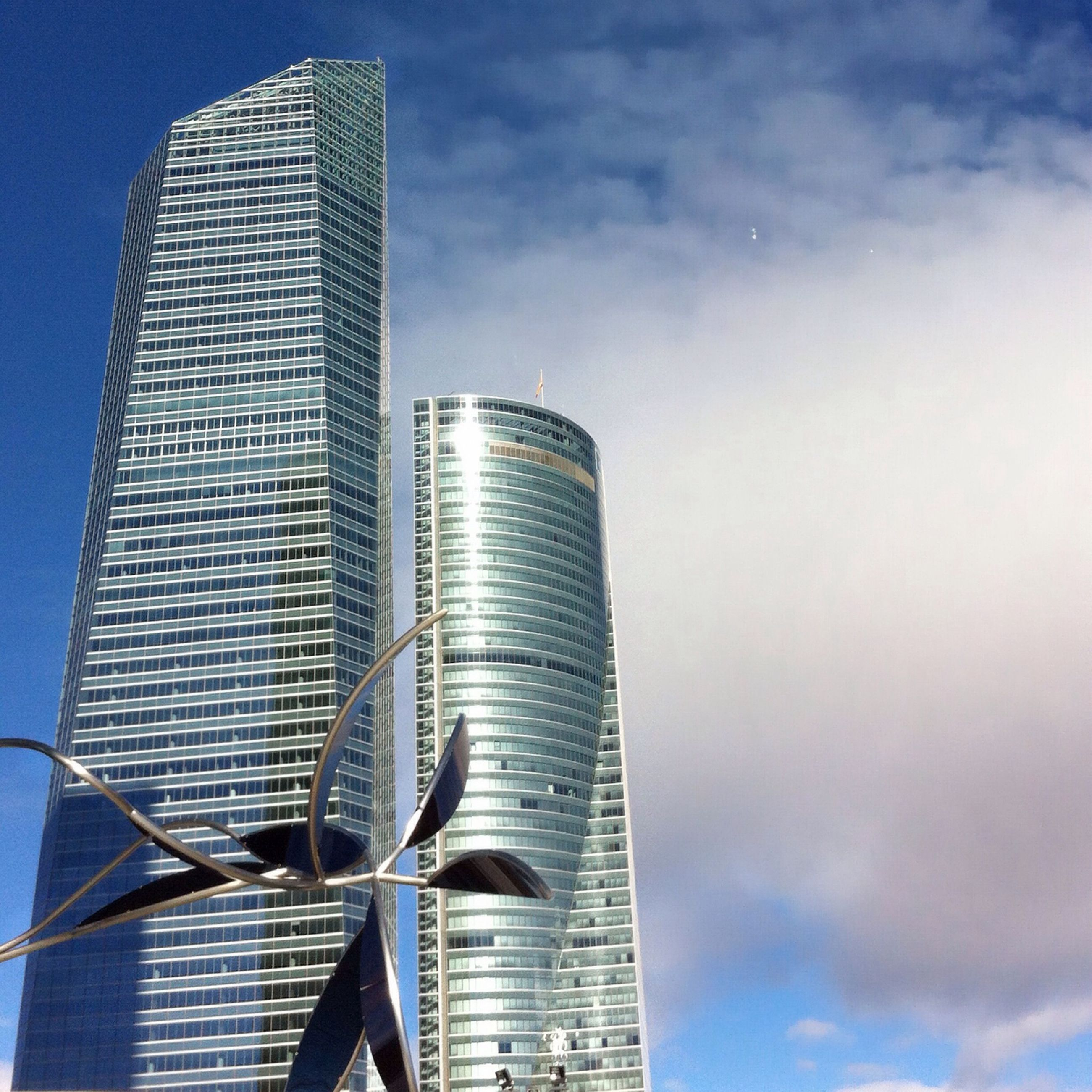 building exterior, architecture, low angle view, built structure, skyscraper, city, modern, tall - high, office building, sky, tower, building, cloud - sky, outdoors, tall, development, glass - material, day, no people, cloud