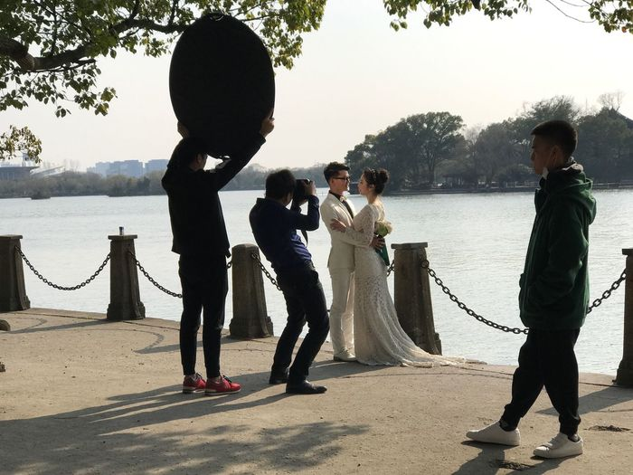 Marriage, Jiaxing, Zhejiang, China, South Lake, February 2017. Wedding Love Wedding Dress Life Events Young Women Real People Men Dedication Young Adult Wife Day Groom Standing Young Men Full Length