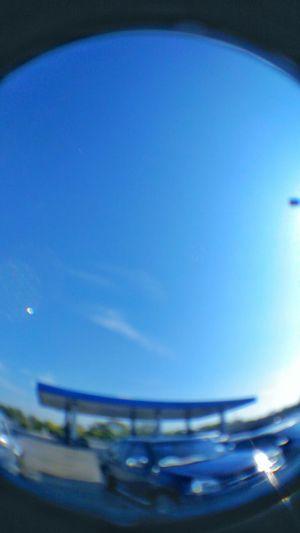 Close-up of nautical vessel against blue sky