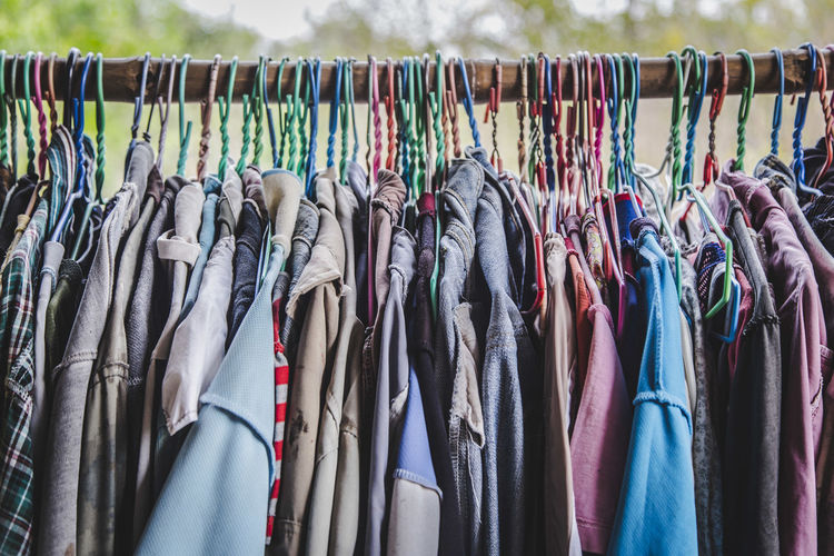 Colorful Clothes Hanging On Rack At Market For Sale