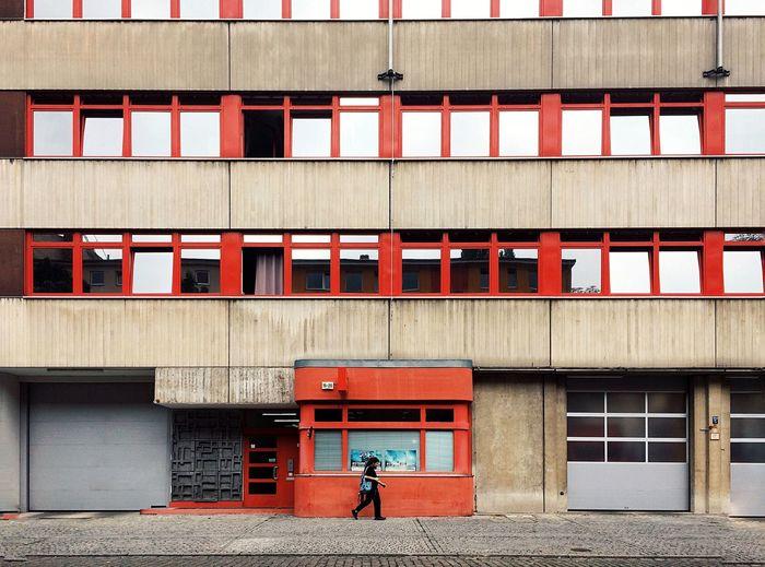 Full length of man standing outside building