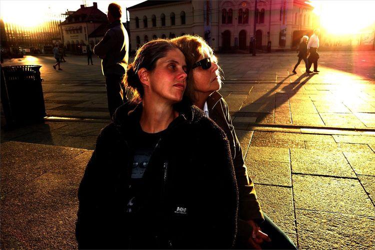 Women standing on street in city